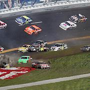 NASCAR Sprint Cup Series drivers Brian Keselowski (92), Andy Lally (71), Joe Nemechek (87), Jimmie Johnson (48), Matt Kenseth (17), Greg Biffle (16), Mark Martin (5), Jeff Gordon (24), Travis Kvapil (38), Brian Vickers (83), Marcos Ambrose (9) and David Reutimann (00) are involved in a multi car crash during the Daytona 500 at Daytona International Speedway on February 20, 2011 in Daytona Beach, Florida. (AP Photo/Alex Menendez)
