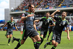 File photo dated 16-06-2016 of Wales' Gareth Bale celebrating scoring his side's first goal against England during the UEFA Euro 2016, Group B match at the Stade Felix Bollaert-Delelis, Lens. Issue date: Tuesday June 1, 2021.