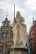Riga, Latvia - August 01, 2015: A statue of St. Roland stands in front of the landmark Blackheads' House, originally builing in 1344, in Riga, Latvia.