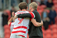 Doncaster Rovers forward John Marquis with Doncaster Rovers Manager Grant McCann on the pitch at full time during the EFL Sky Bet League 1 match between Doncaster Rovers and Bradford City at the Keepmoat Stadium, Doncaster, England on 22 September 2018.