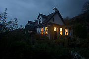 "A night landscape landscape of the remote Lip na Cloiche, a garden, arts shop and bed+breakfast cottage run by Lucy McKenzie, near Ulva ferry, Isle of Mull, Scotland. Beyond is Loch Tuath and the headland of the Island of Ulva. Lip na Cloiche is a small, densely-planted garden on the Isle of Mull, open to the public. Lip na Cloiche garden is beautifully situated close to the shoreline of the Isle of Mull, and has stunning views of Loch Tuath and the Isle of Ulva. A wide range of such plants is available for sale throughout the year, as well as fresh eggs and many craft items made from locally ""found"" materials. There is no admission charge. http://www.lipnacloiche.co.uk"