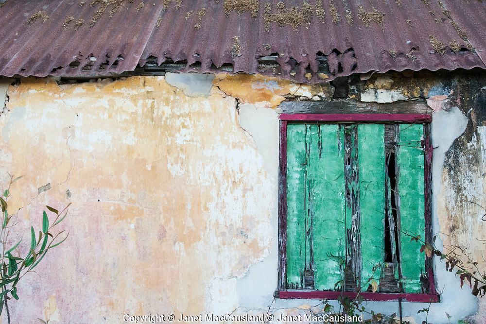 One of the things I like the most about travel is the different color combinations found in the decoration of homes and buildings. Here in this photograph the interesting colors are also combined with interesting textures unlike my home. I call it Archi-texture.