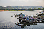 A tiny barge sails on the Perfume River in Hue, Vietnam, Southeast Asia