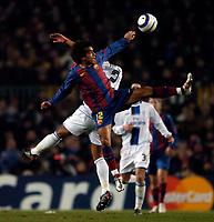 Photo. Jed Wee, Digitalsport<br /> FC Barcelona v Chelsea, UEFA Champions League, 23/02/2005.<br /> Barcelona's Giovanni van Bronckhorst gets tangled with Chelsea's Glen Johnson