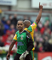 Photo: Rich Eaton.<br /> <br /> Tamworth FC v Norwich City. The FA Cup. 06/01/2007. Jose Veiga the Tamworth keeper is dejected as Dion Dublin of Norwich at rear celebrates making the score 3-0