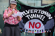 Victoria Rance, Coordinator of Stop The Silvertown Tunnel Coalition, addresses environmental activists and local residents protesting against the construction of the Silvertown Tunnel on 5th June 2021 in London, United Kingdom. Campaigners opposed to the controversial new £2bn road link across the River Thames from the Tidal Basin Roundabout in Silvertown to Greenwich Peninsula argue that it is incompatible with the UKs climate change commitments because it will attract more traffic and so also increased congestion and air pollution to the most polluted borough of London.