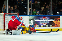 KELOWNA, BC - DECEMBER 18: David Gustafsson #27 of Team Sweden falls into the net of Petr Kochetkov #20 of Team Russia during first period at Prospera Place on December 18, 2018 in Kelowna, Canada. (Photo by Marissa Baecker/Getty Images)***Local Caption***