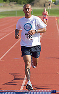 Central Valley, New York - Fernando Cruz finishes the Woodbury Country Ramble race on Aug. 26, 2012.