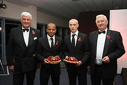CARDIFF, WALES - Wednesday, November 11, 2009: Wales' Robert Earnshaw and David Cotterill receive their international caps from General Secretary David Collins (L) and President Phil Pritchard (R) during the Football Association of Wales Player of the Year Awards hosted by Brains SA at the Cardiff City Stadium. (Pic by David Rawcliffe/Propaganda)