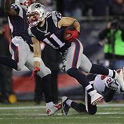 FOXBOROUGH, MASSACHUSETTS - JANUARY 14:  Wide receiver Julian Edelman #11 of the New England Patriots in action during the Houston Texans Vs New England Patriots Divisional round game during the NFL play-offs on January 14th, 2017 at Gillette Stadium, Foxborough, Massachusetts. (Photo by Tim Clayton/Corbis via Getty Images)