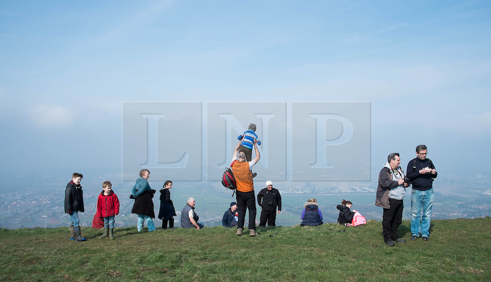 © Licensed to London News Pictures. 29/03/2014<br /> <br /> Eston Hills, Teesside, United Kingdom<br /> <br /> Families who are part of a community group called the Friends of Eston Hills gather on the top of Eston Nab in Teesside. The group who have recently raised £15000 in just seven weeks to buy the land and return it to public ownership gathered to celebrate on top of the Nab.<br /> <br /> The area will now be returned to public ownership for the first time in hundreds of years and there are plans to raise more funds to create a heritage trail, clean the site up and create a memorial to 375 miners who died when there was an iron mine on the site.<br /> <br /> <br /> Photo credit : Ian Forsyth/LNP