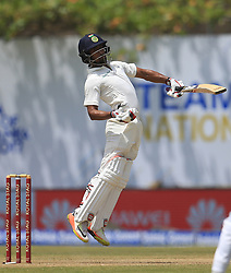 July 27, 2017 - Galle, Sri Lanka - Indian cricketer Wriddhiman Saha reacts as he leaves a  bouncer ball  during  the 2nd Day's play in the 1st Test match between Sri Lanka and India at the Galle International cricket stadium, Galle, Sri Lanka on Thursday 27 July 2017. (Credit Image: © Tharaka Basnayaka/NurPhoto via ZUMA Press)