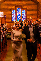The bride and groom come down the aisle after the wedding ceremony, Plassen Church (kirke), a wooden (stave) church originally built in 1879. It burnt to the ground in 1904 and was rebuilt in 1907. Trysil, Norway.