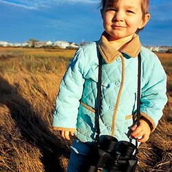 Biddeford, ME. A budding young naturalist explores a salt marsh near Biddeford Pool.  TPL project - Anuszewski property.