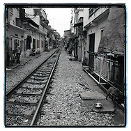 View of buildings and houses constructed along the railway in Hanoi. In this place the train cross the city just in front of house's doors.