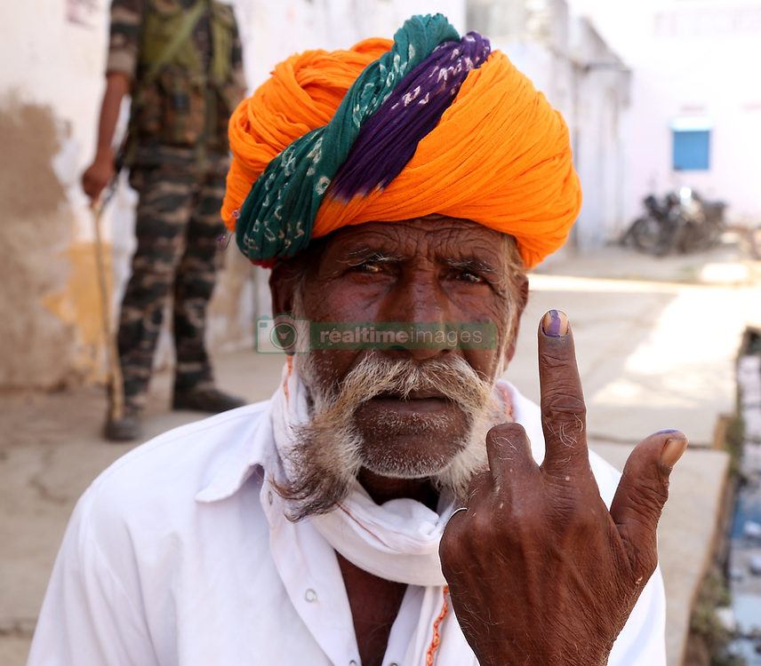 April 29, 2019 - Rajasthan, India - An Indian voter shows ink-marked finger after casting vote for the fourth phase of India's general election in outskirts village of Mangliyawas, Rajasthan India. (Credit Image: © Str/NurPhoto via ZUMA Press)