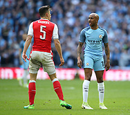 Arsenal's Gabriel tussles with Manchester City's Fabian Delph during the FA Cup Semi Final match at Wembley Stadium, London. Picture date: April 23rd, 2017. Pic credit should read: David Klein/Sportimage