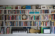 A busy bookshelf at Cressingham Gardens on 20th September 2015 in South London, United Kingdom. Cressingham Gardens is a council garden estate, located on the southern edge of Brockwell Park. It comprises of 306 dwellings and built to the design of Lambeth Borough Council architect Edward Hollamby in the early 1970s. In 2012, Lambeth Council proposed regeneration of the estate, a decision highly opposed by many residents. Since the announcement, the highly motivated campaign group Save Cressingham Gardens has been active.