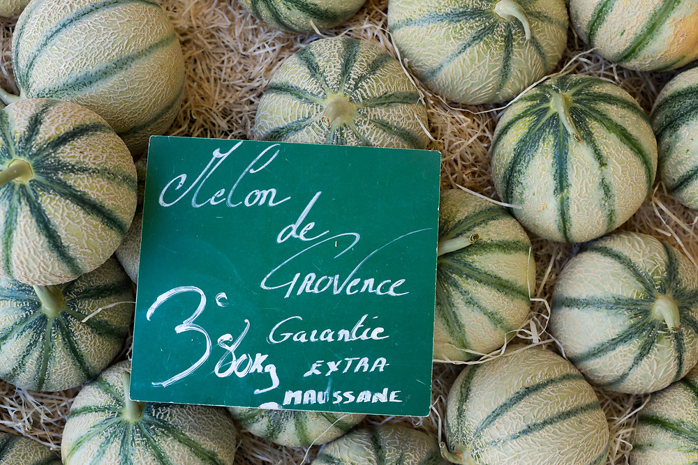 Fresh melons for sale at the Saturday market in Aix-en-Provence, France