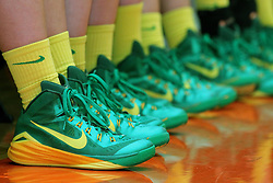 27 December 2014:  A team of basketball players all sport the same golden yellow socks and green and gold nike sneakers. This image available for EDITORIAL USE ONLY. A release may be required. Additional information by contacting alook at alanlook.com