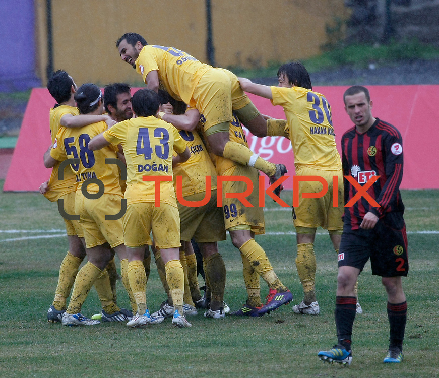 Eyupspor's players celebrate goal during their Turkey Cup matchday 3 soccer match Eyupspor between Eskisehirspor at Eyup Stadium in Istanbul Turkey on Wednesday, 11 January 2012. Photo by TURKPIX