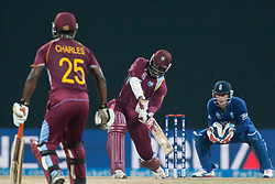 © Licensed to London News Pictures. 27/09/2012. West Indian batsmen Chris Gayle batting during the T20 Cricket World super 8's match between England Vs West Indies at the Pallekele International Stadium Cricket Stadium, Pallekele. Photo credit : Asanka Brendon Ratnayake/LNP