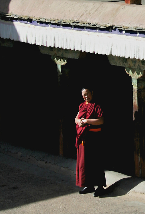 walking among the monks in lhasa tibet, I was captivated with this monk who looks so still and contemplative. we shared a nod, and a picture and a peaceful moment in time