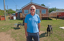 ©Licensed to London News Pictures 06/08/2020 Eastchurch, UK. Ed Cane has been told to move out by the council, Ed standing in his garden in front of his home which is next door to the cliff fall property. Residents in Eastchurch on the Isle of Sheppey, Kent have been advised to move by the local council as their homes are at risk from landslides. The advice comes ten weeks after a massive landslide destroyed a family home and sent it tumbling down a cliff leaving a family homeless. Photo credit: Grant Falvey/LNP