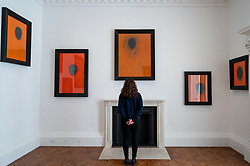 "© Licensed to London News Pictures. 12/04/2021. LONDON, UK. A staff member poses at the opening of Swiss artist Not Vital's ""Paintings"" exhibition at Thaddaeus Ropac's Ely House gallery in Mayfair. These works include portraits painted on to monk's robes from Laos. The UK government's coronavirus roadmap out of lockdown has allowed art galleries to reopen today.  The exhibition runs 13 April to 26 May 2021.  Photo credit: Stephen Chung/LNP"