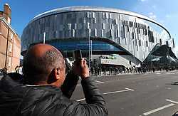 A fans takes a picture of the new Tottenham Hotspur's stadium prior to the U18 Premier League test event match at Tottenham Hotspur Stadium, London.