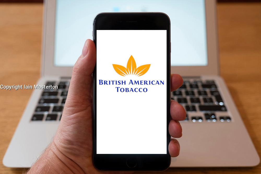 Using iPhone smartphone to display logo of BAT, British American Tobacco company