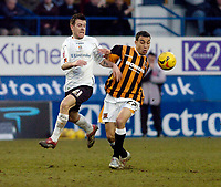 Photo: Leigh Quinnell.<br /> Luton Town v Hull City. Coca Cola Championship. 04/02/2006. Lutons Keith Keane battles with Hulls Craig Fagan.