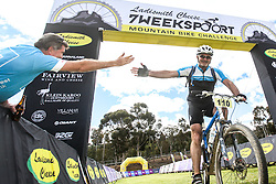 An 82km marathon finisher gets a high five from an earlier finisher of the Ladismith Cheese 7Weekspoort MTB Challenge, on the 1st October 2016<br /> <br /> Photo by:    /Oakpics/ SPORTZPICS<br /> <br /> <br /> {dem16gst}