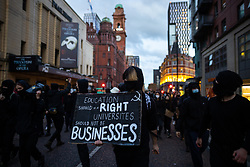 © Licensed to London News Pictures. 10/05/2021. Manchester, UK. Students at the University of Manchester protest and march through Manchester City Centre , over their living and learning conditions . The occupation of the University's Samuel Alexander building by students continues , as demonstrators say they have been let down over fees and rental charges under Coronavirus , the actions of police and private security on campus and the University's responses to students' concerns , over the last twelve months . Photo credit: Joel Goodman/LNP