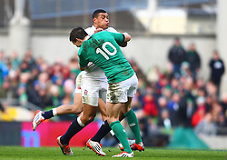 England's Luther Burrell is tackled by Ireland's Jonathan Sexton - Photo mandatory by-line: Ken Sutton/JMP - Mobile: 07966 386802 - 01/03/2015 - SPORT - Rugby - Dublin - Aviva Stadium - Ireland v England - Six Nations