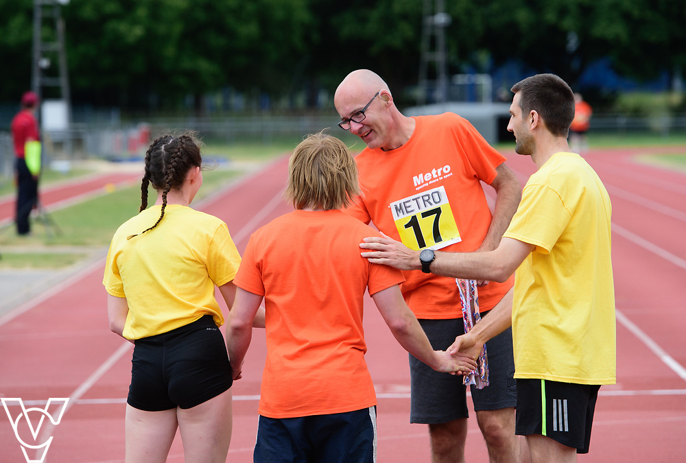 Event: 400 meters<br /> Competitors, from left: Warren Wilson and David Beynon<br /> <br /> Metro Blind Sport's 42nd Athletics Open, held at Mile End Stadium, Tower Hamlets, London.<br /> <br /> Picture: Chris Vaughan Photography for Metro Blind Sports<br /> Date: June 16, 2018