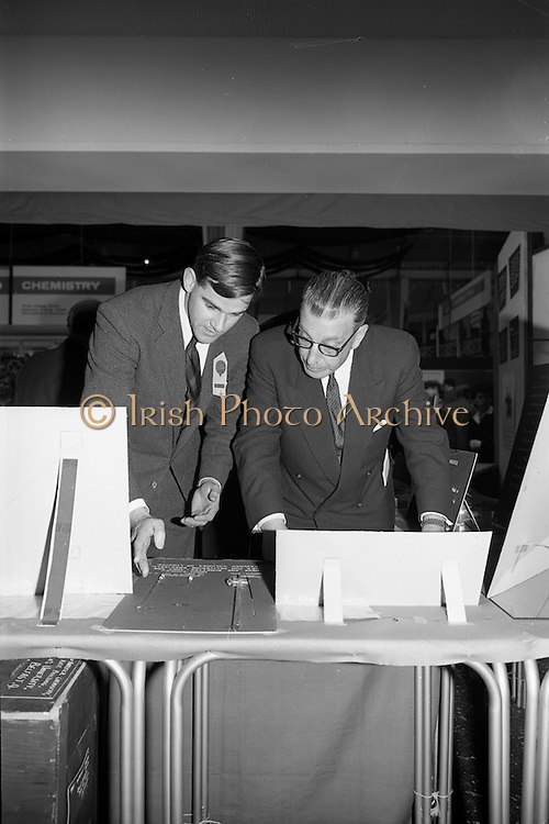 22/10/1963<br /> 10/22/1963<br /> 22 October 1963<br /> R.D.S. Scientific Exhibition opens. Queen's University Belfast Chemistry stand at the exhibition. Taoiseach Sean Lemass (right) with Mr. Colm Graham, research Chemist at Queen's.