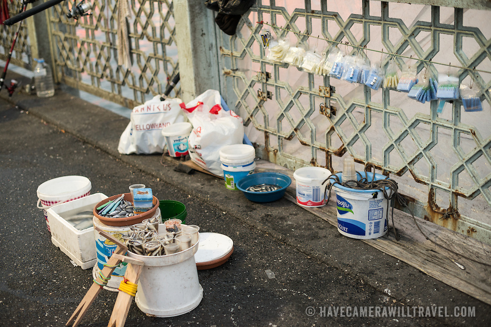 A fisherman's supplies are arranged in his spot on Galata Bridge. Spanning the Golden Horn and linking Eminonu with Karakoy, the Galata Bridge is a dual-level bridge that handles road, tram, and pedestrian traffic on the top level with restaurants and bars on the level below.