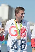 "Rio de Janeiro. BRAZIL.   Pete REED, GBR W8+ Silver Medalist, awards dock. 2016 Olympic Rowing Regatta. Lagoa Stadium,<br /> Copacabana,  ""Olympic Summer Games""<br /> Rodrigo de Freitas Lagoon, Lagoa.   Saturday  13/08/2016 <br /> <br /> [Mandatory Credit; Peter SPURRIER/Intersport Images]"