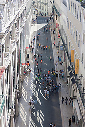 Group of people walking in street, Lisbon, Portugal