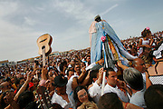 A guitar is raised to pay homage to Saint Sara. Gypsy Roma and Gitan pilgrims carry Saint Sara to the seashore during the Gypsy Pilgrimmage of Saintes Maries de la Mer<br /><br />Europe, France, Camargue, Saintes Maries de la Mer, Gypsy Pilgrimmage 'Pelerinage des Gitans aux Saintes Maries de la Mer'. Gypsies from all over the world come to celebrate their patron Saint Sara who is carried by them from the church to the sea-shore. May 24th and 25th every year