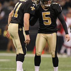 16 January 2010:  New Orleans Saints PK Garrett Hartley (5) celebrates with Mark Brunell (11) after kicking a field goal during a 45-14 win by the New Orleans Saints over the Arizona Cardinals in a 2010 NFC Divisional Playoff game at the Louisiana Superdome in New Orleans, Louisiana.