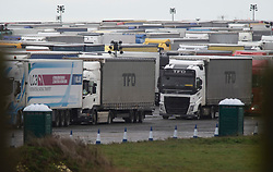 © Licensed to London News Pictures 23/12/2020.        Manston, UK. Lorries at the airport. The Army and NHS staff have arrived at Manston Airport to administer Covid-19 lateral flow tests to truckers who are stranded in Kent. Angry lorry drivers blockading local roads and clashed with police in Kent this morning. France have closed its borders to all freight traffic because of the new Coronavirus strain. Photo credit:Grant Falvey/LNP