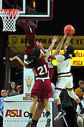 March 18, 2016; Tempe, Ariz;  New Mexico State Aggies forward Tyesha Taylor (50) blocks a shot by Arizona State Sun Devils guard Arnecia Hawkins (1) during a game between No. 2 Arizona State Sun Devils and No. 15 New Mexico State Aggies in the first round of the 2016 NCAA Division I Women's Basketball Championship in Tempe, Ariz. The Sun Devils defeated the Aggies 74-52.