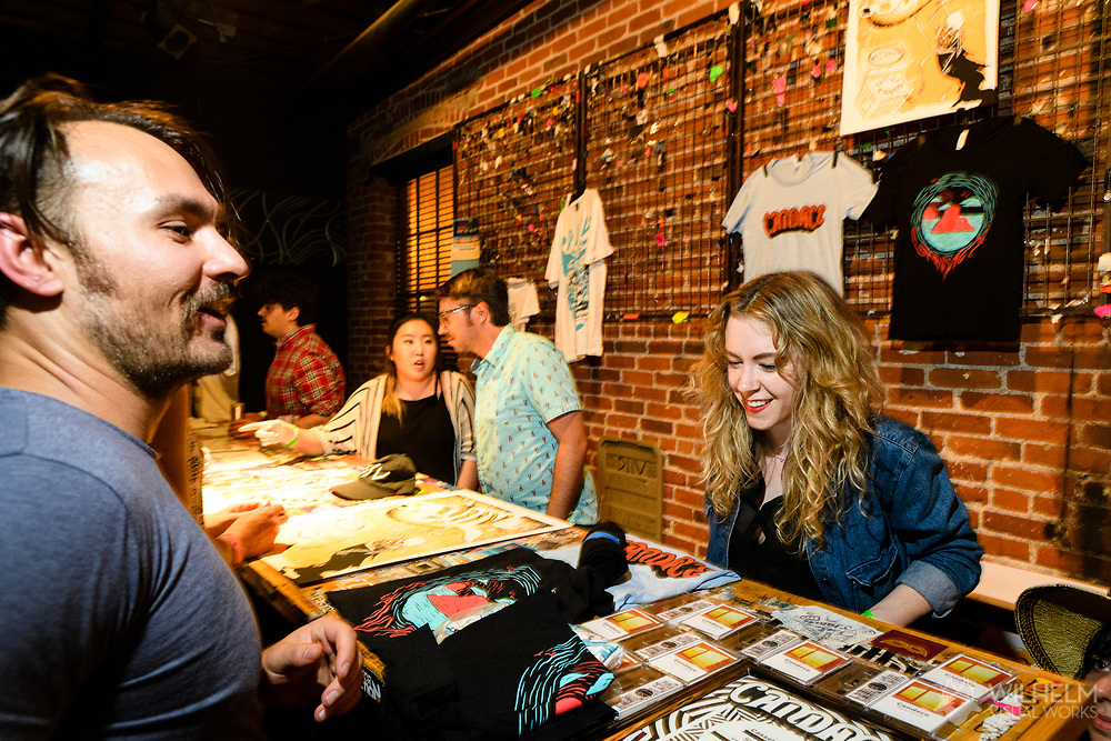 Attendees at the merchandise table at Red Bull Sound Select Presents Denver at the Summit Music Hall in Denver, CO, USA, on 13 May, 2017.