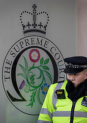 © Licensed to London News Pictures. 05/12/2016. London, UK. A policeman stands outside the Supreme Court in Westminster, London for first day of a Supreme Court hearing to appeal against a November 3 High Court ruling that Article 50 cannot be triggered without a vote in Parliament. Photo credit: Peter Macdiarmid/LNP