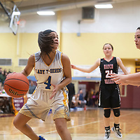 Zuni's Kaitlin Romancito (4) drives to the basket against Hatch Valley Saturday during the championship game of the Rehoboth Christian High School girls basketball tournament in Rehoboth.