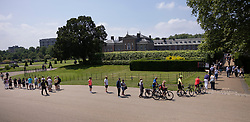 © Licensed to London News Pictures. 02/07/2021. London, UK. Members of the public queue to enter the grounds of Kensington Palace to view a new statue of Diana, Princess of Wales, which was unveiled by Prince William and Prince Harry yesterday afternoon. Photo credit: Peter Macdiarmid/LNP