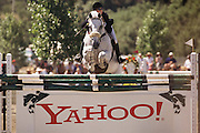 Silicon Valley, California; The Portola Valley Classic, a horse jumping competition sponsored in part by Hewlett Packard, Yahoo, Nasdaq, Mercedes, and Cartier is held at the Portola Valley Training Center, the largest equine boarding facility in Northern California. The grand prize for the competition in 1999 is $25,000. Other prizes consist of sponsor's products. Rider and horse clear over a Yahoo! jump. (1999).