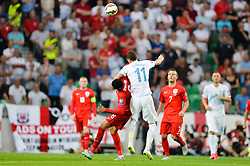 Milivoje Novakovic of Slovenia and Chris Smalling of England during the EURO 2016 Qualifier Group E match between Slovenia and England at SRC Stozice on June 14, 2015 in Ljubljana, Slovenia. Photo by Mario Horvat / Sportida